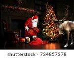 christmas night  santa claus... | Shutterstock . vector #734857378