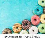 top view of assorted donuts on... | Shutterstock . vector #734867533