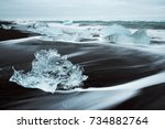 icy beach in iceland  europe.... | Shutterstock . vector #734882764