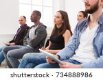 group of people sitting at... | Shutterstock . vector #734888986