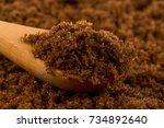 brown muscovado sugar in wooden ... | Shutterstock . vector #734892640