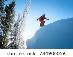 freeride snowboarder riding on... | Shutterstock . vector #734900056