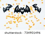 black glitter bats and candy... | Shutterstock . vector #734901496