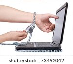 Color photo of a man's hand and computer - stock photo