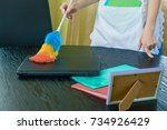 hands of housemaid  dusting.... | Shutterstock . vector #734926429