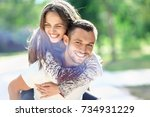 man carrying his girlfriend on... | Shutterstock . vector #734931229