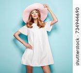 blonde young woman in summer... | Shutterstock . vector #734944690