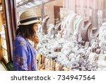 woman in hat looking to...   Shutterstock . vector #734947564