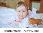 baby girl with blue eyes lies... | Shutterstock . vector #734947600