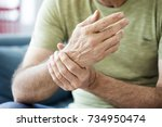 old man suffering from pain and ... | Shutterstock . vector #734950474