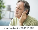 old man with ear pain | Shutterstock . vector #734951230