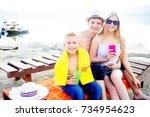 family on a beach | Shutterstock . vector #734954623