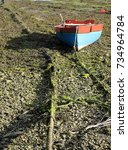 Small photo of Frap mooring. A local Cornish boat dried out on a frap mooring in Cornwall England,UK.