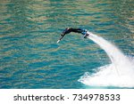 dolphin style during a flyboard ...   Shutterstock . vector #734978533