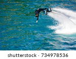 dolphin style during a flyboard ...   Shutterstock . vector #734978536
