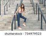 walk with a stylish blonde in... | Shutterstock . vector #734979523