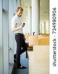relaxed businessman having a... | Shutterstock . vector #734980906