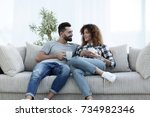 beautiful couple holding a cup... | Shutterstock . vector #734982346
