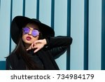 fashion portrait of young... | Shutterstock . vector #734984179