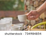 cropped hand of man takes a cup ... | Shutterstock . vector #734984854