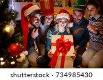 happy smiling friends opening... | Shutterstock . vector #734985430