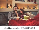 young chrismas couple enjoy... | Shutterstock . vector #734985694