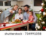 family taking selfie together... | Shutterstock . vector #734991058