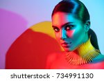Stock photo high fashion model woman in colorful bright lights posing portrait of beautiful sexy girl with 734991130