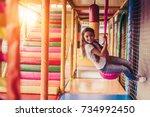 little pretty girl is having... | Shutterstock . vector #734992450