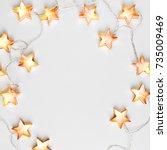 star shaped christmas lights... | Shutterstock . vector #735009469