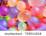 colorful water balloons in a...   Shutterstock . vector #735011818