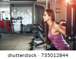 pretty sporty girl training in... | Shutterstock . vector #735012844
