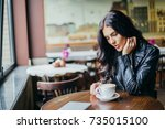 young pretty spanish woman in... | Shutterstock . vector #735015100