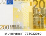 Photo of two hundred euro banknote in macro shot. High resolution photo. - stock photo