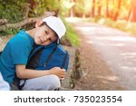 a boy with a backpack and a cap ... | Shutterstock . vector #735023554