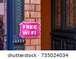 free wi fi   vintage pink sign... | Shutterstock . vector #735024034