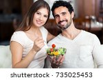 happy couple eating a healthy... | Shutterstock . vector #735025453