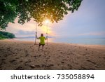 young woman sitting on a swing... | Shutterstock . vector #735058894