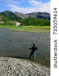 Small photo of A man fly fishes in an Alaskan stream