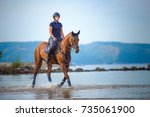girl riding a horse on... | Shutterstock . vector #735061900