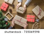 gives a gift christmas presents ... | Shutterstock . vector #735069598
