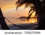 beautiful golden sunrise over...   Shutterstock . vector #735075589
