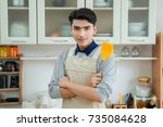 asian young man is cooking | Shutterstock . vector #735084628
