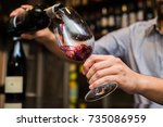 Waiter Pouring Red Wine In A...