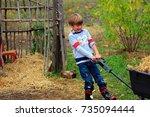 a little caucasian boy pulling... | Shutterstock . vector #735094444