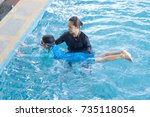 girl learning to swim with... | Shutterstock . vector #735118054