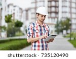 shot of a young male architect... | Shutterstock . vector #735120490