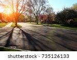 suburban street with... | Shutterstock . vector #735126133