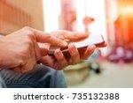 man using a modern mobile phone ... | Shutterstock . vector #735132388