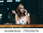 young woman is having... | Shutterstock . vector #735133276